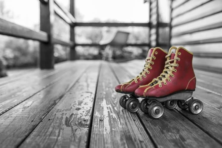 Red vintage skates on black and white background