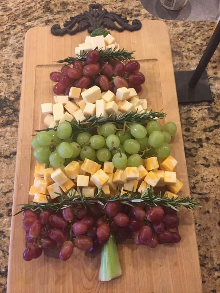 Christmas Tree Design on a wood block made of grapes, rosemarry, and cheese cubes