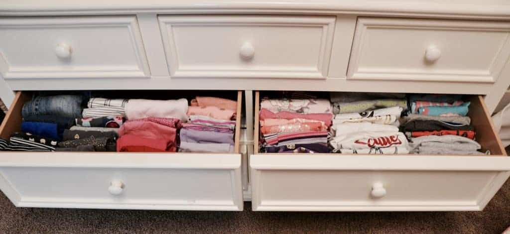 Pants drawer and shirt drawer with neatly folded vertically filied clothes.