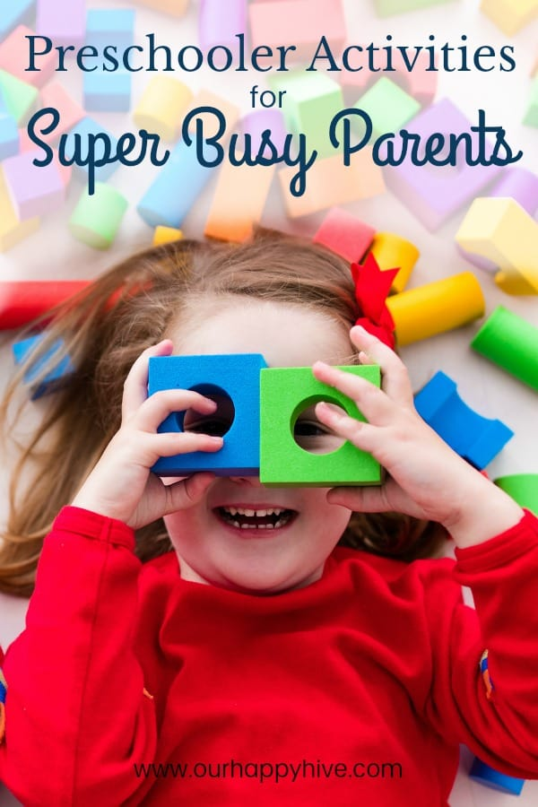 Preschooler laying down with foam blocks with circles cut out over her eyes with Text Preschooler Activities for Super Busy Parents