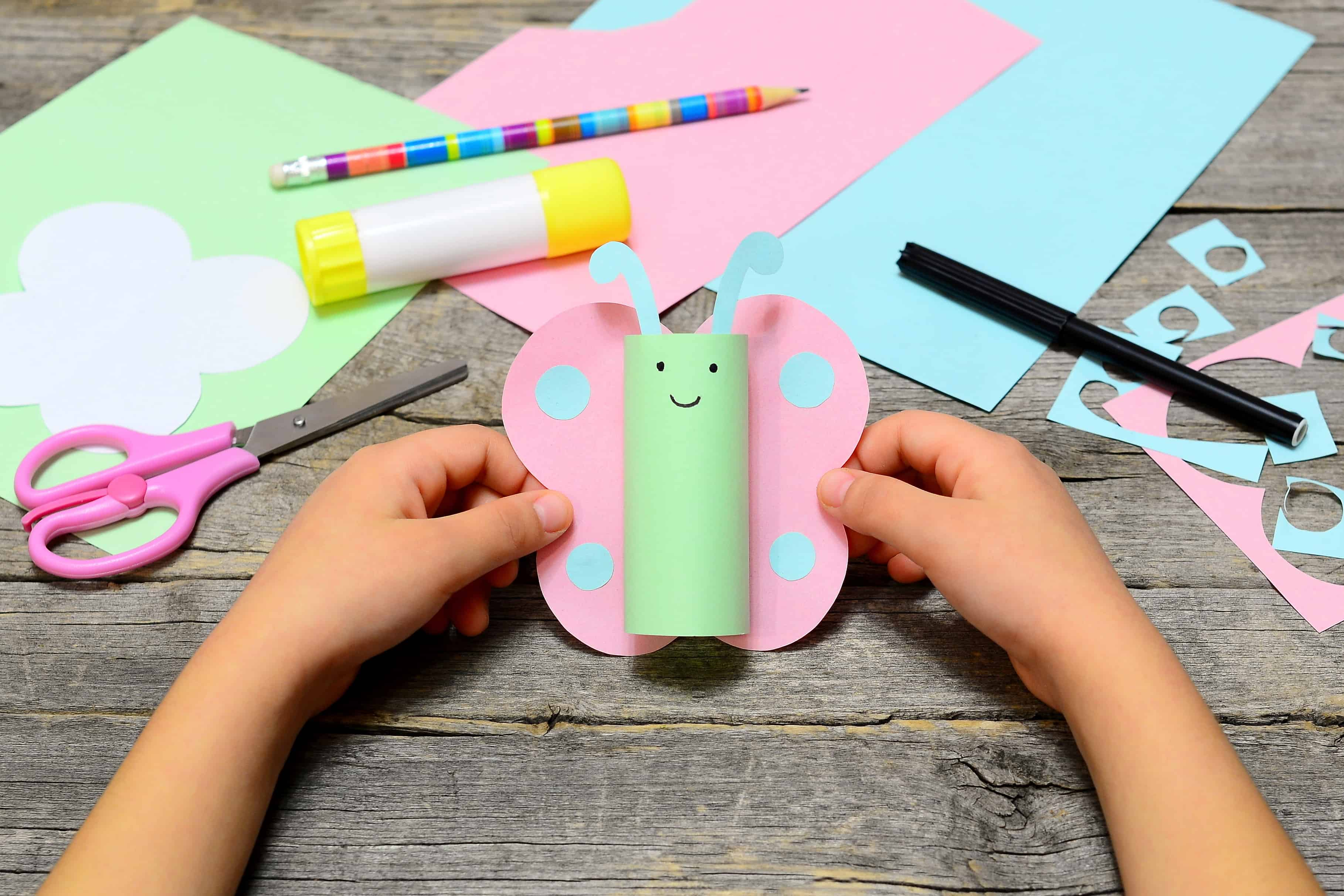 Preschooler craft with paper, scisors, and glue.