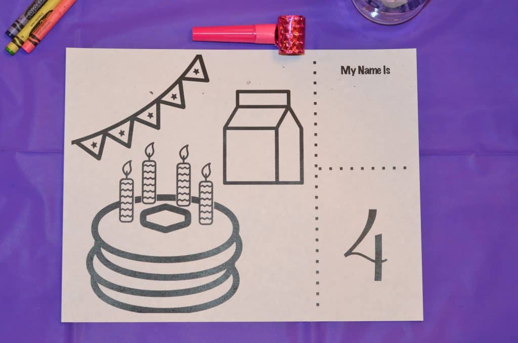 Birthday party coloring page with pancakes, candles, banners, and milk.