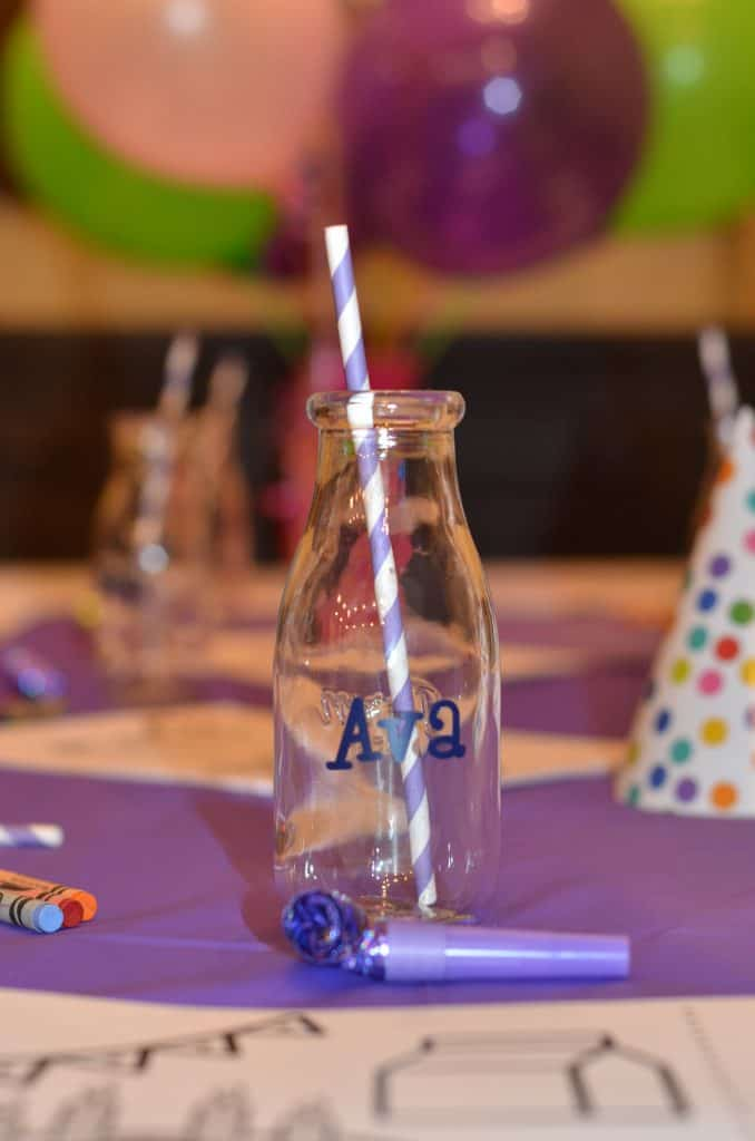 close up of a milk jug customized with party guests name.