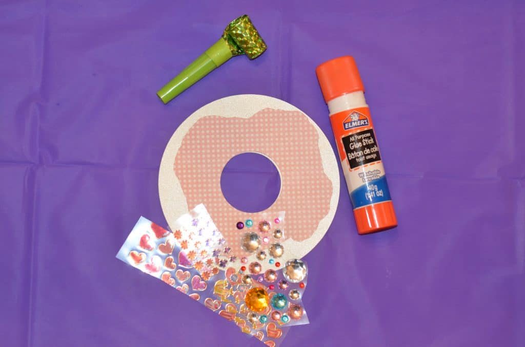 Decorate your own doughnut craft with stickers and glue
