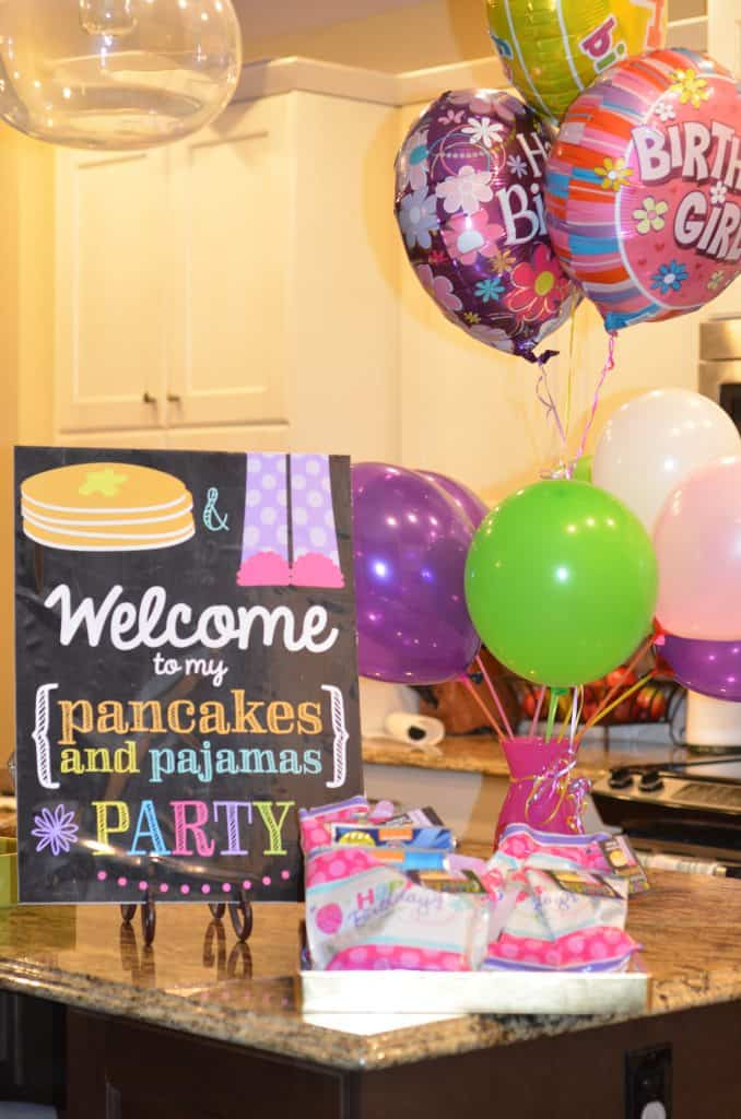 Party sign, party favors, and baloons.