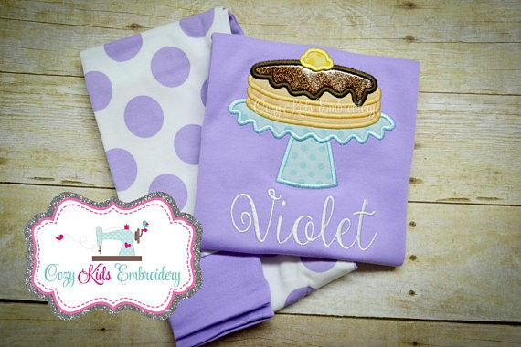 Purple pajamas with a pancake and embroidered name on it.