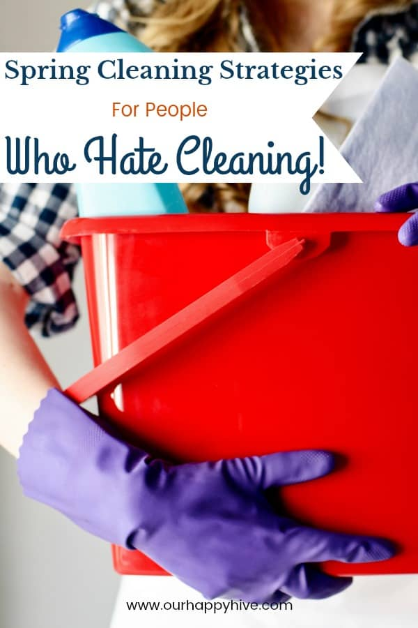 Woman wearing latex cleaning glove holding a bucket with cleaning products with Text - Wpring Cleaning Strategies For People Who Hate Cleaning
