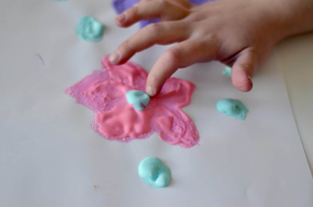 Close up of a preschooler's hand touching dried puffy paint