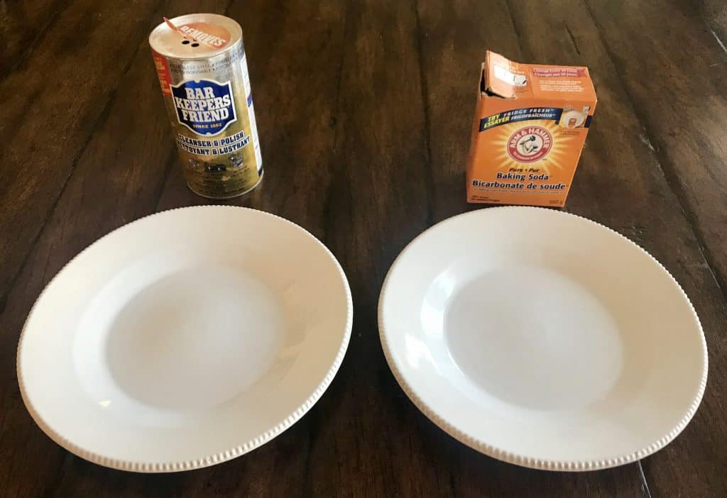 two white plates one with Bar keepers friend above it and the other with baking soda above it