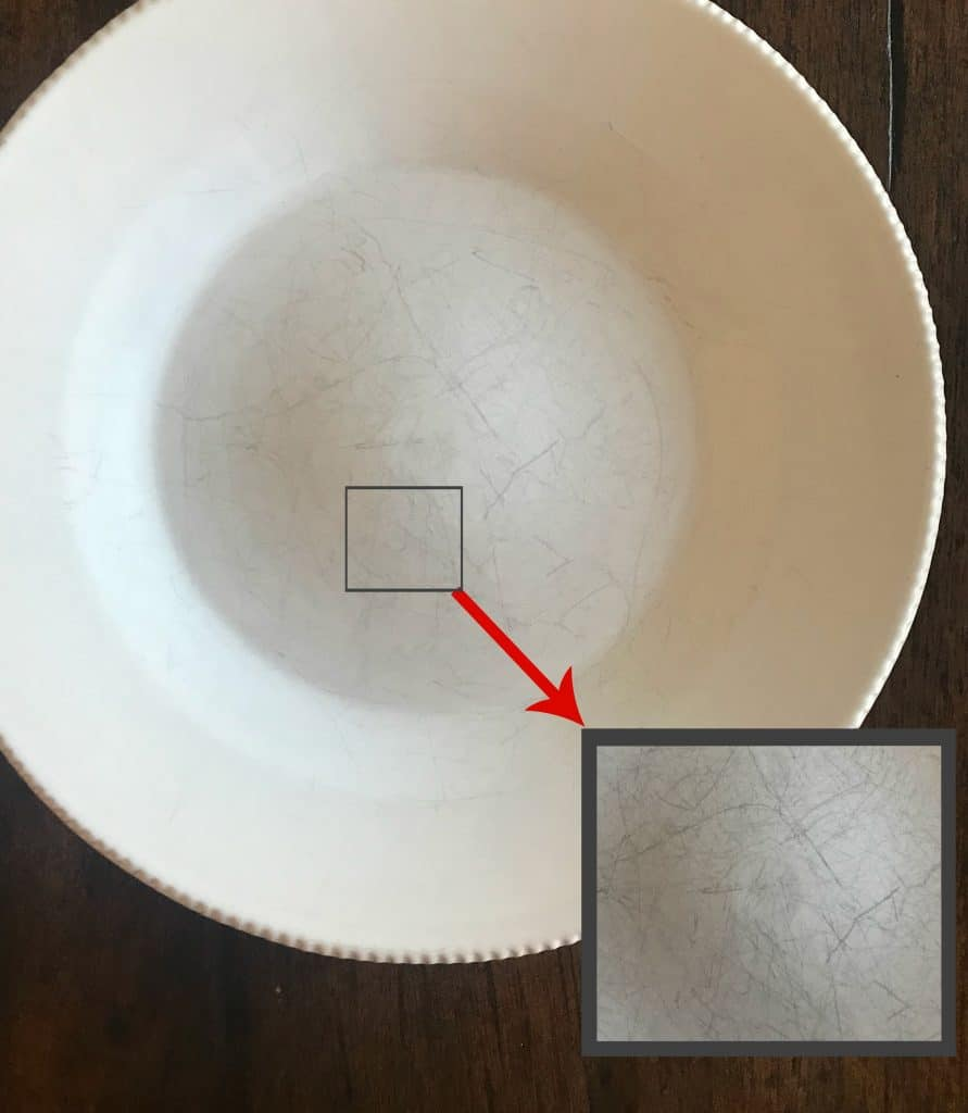 a scratched dish with a square showing an enlargement of the scratched area