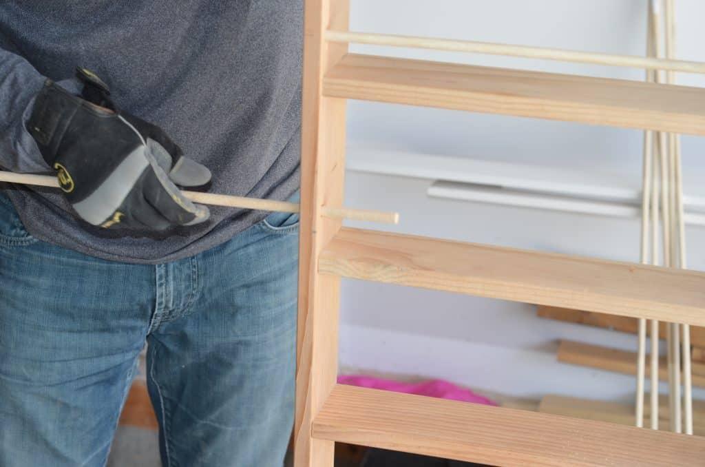 Placing dowel rod in frame