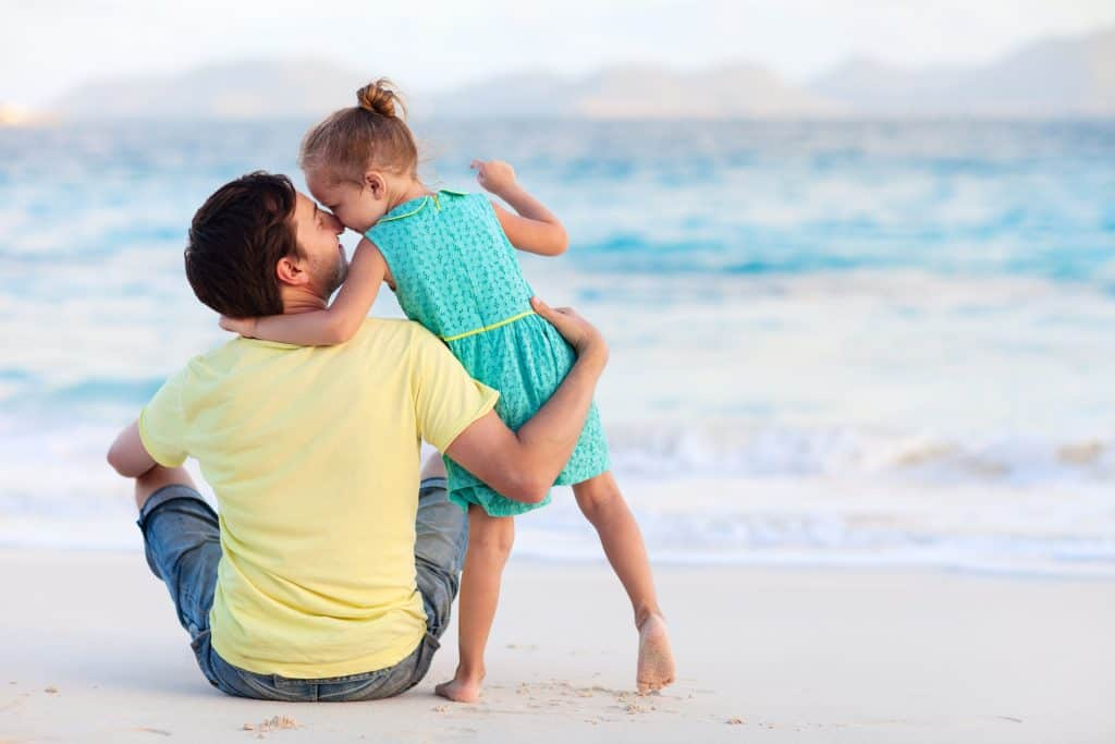 Happy father and daughter at beach