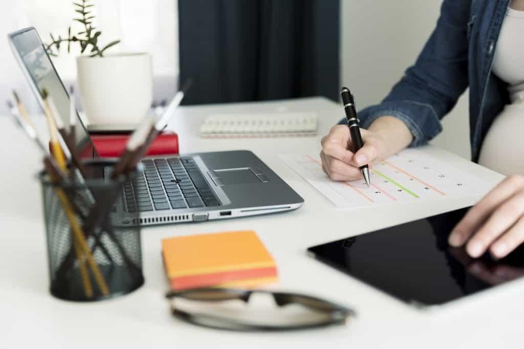 Calendar planner agenda schedule concept. Woman working in her office, working, planning.