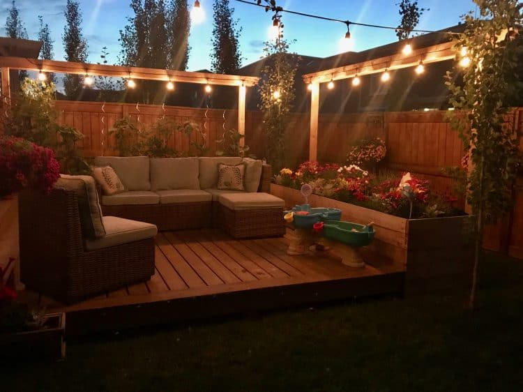 Backyard with flower and vegetable garden and string lights