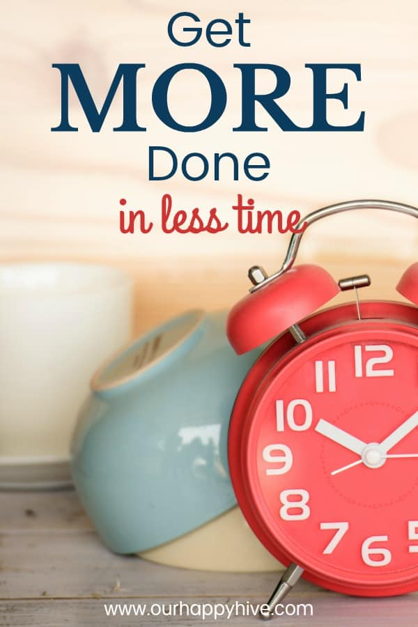Close up of red alarm clock on counter with dishes in the background and Text - Get More Done in Less Time