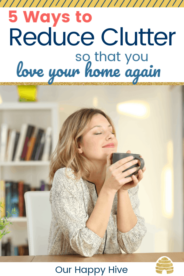 Woman who loves her clutter free home after decluttering with text 5 ways to reduce clutter so that you love your home again.
