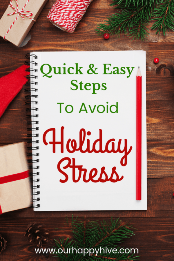 Desktop with christmas decorations and notepad that says quick and easy steps to avoid holiday stress