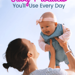 mom holding up a baby wiht text 15 Baby Products You'll Use Every Day
