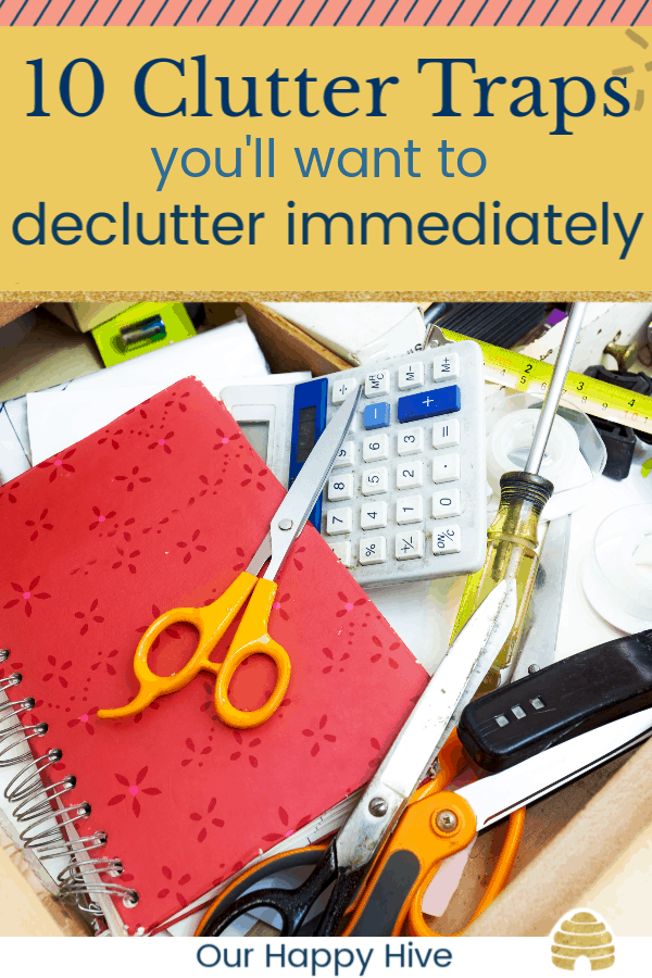 Junk Drawer filled with clutter with text 10 clutter traps you'll want to declutter immediately