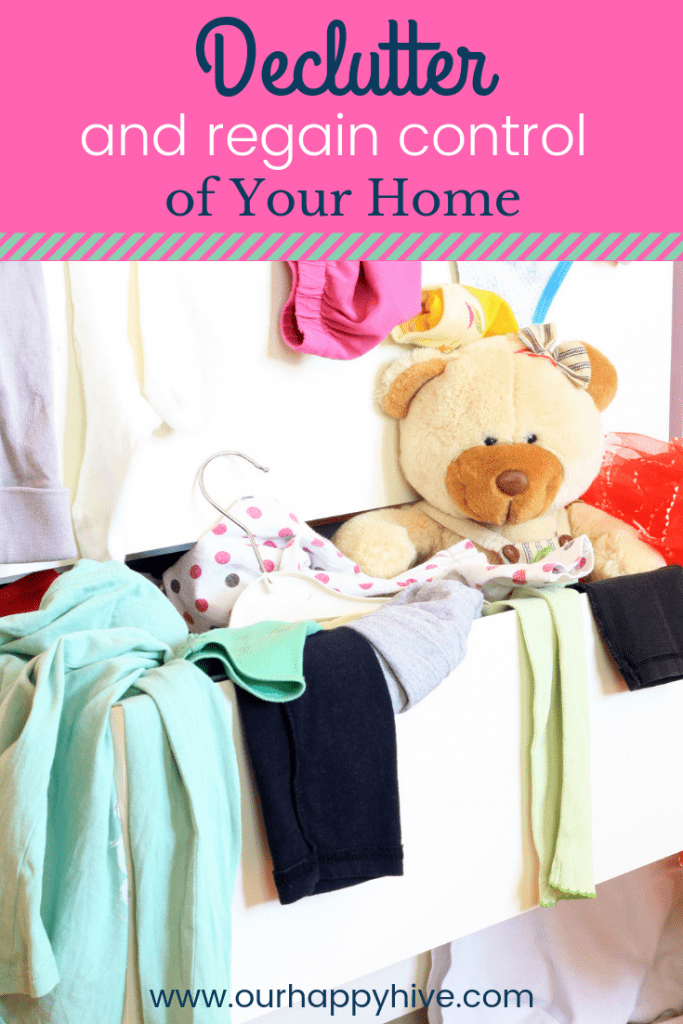 Messy child room with clothes in the drawer with text Declutter and regain control of your home