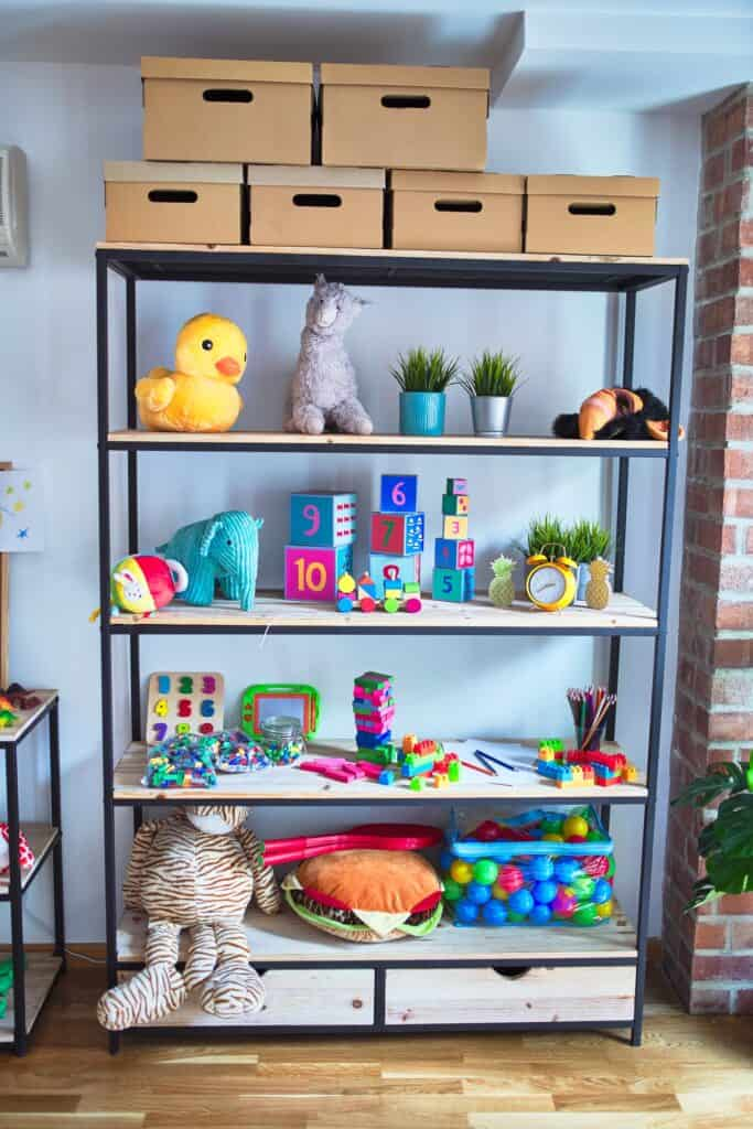 organized playroom shelves with toys and storage boxes