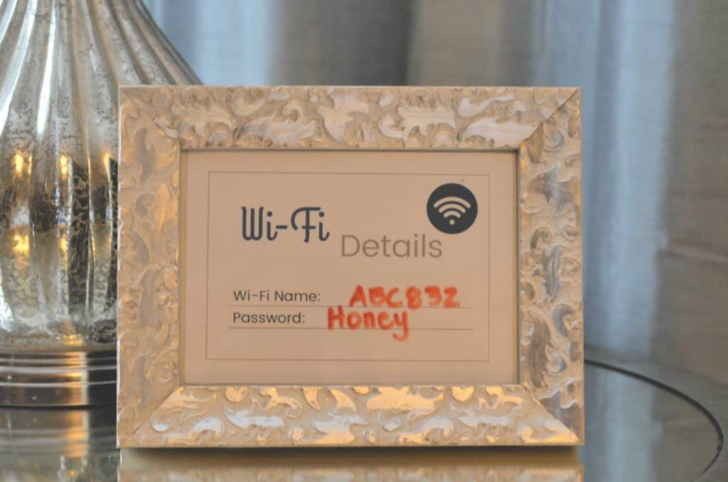Close Up of a Frame with the Home's wi-fi Details on it for guests.