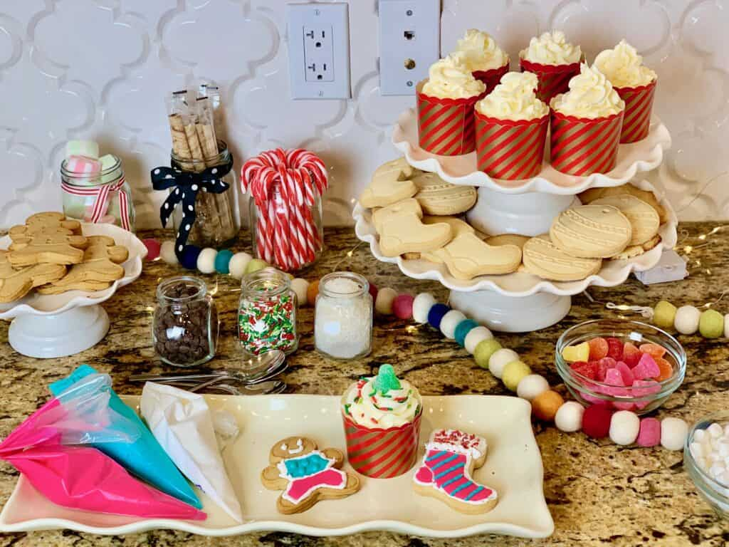 diy christmas cookie bar with topings and icing for guests to decorate