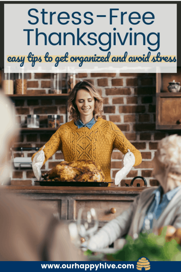 a lady getting the turkey out of the oven while family wait at the table with text stress-free thanksgiving easy tips to get organized and avoid stress