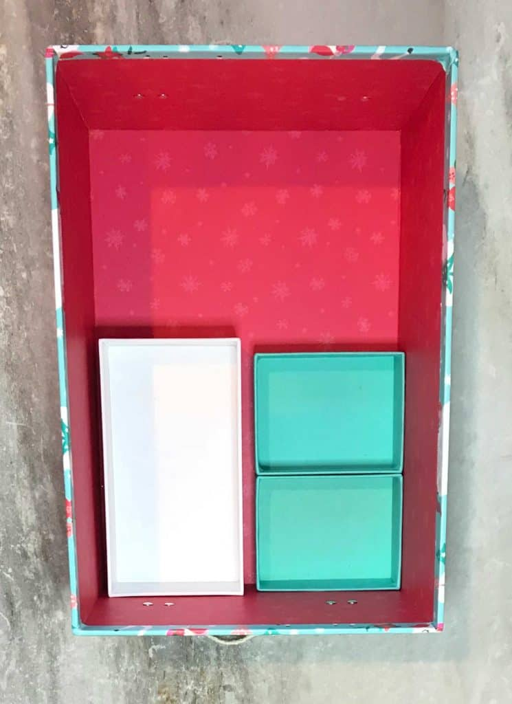 inside of shoe box colored pink, with three boxes fitting inside of it to compartmentalize sections