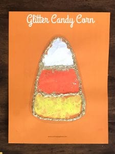 Candy Corn painted with a cork stamp and outlined in gold glitter.