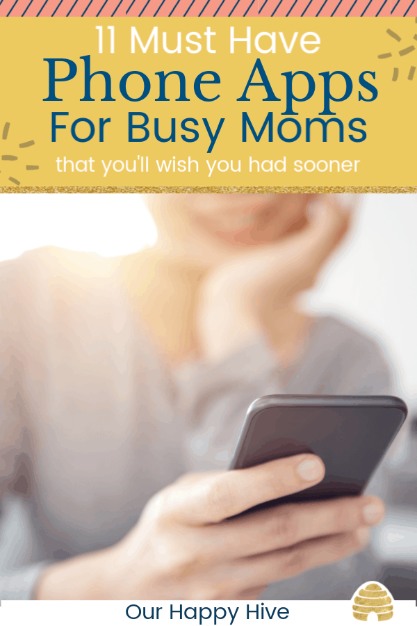 Mom looking at app on her phone with text 11 Must Have Phone Apps For Busy Moms