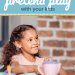 young girl smiling with a play tea set in front of her and text Inspiring pretend play with your kids