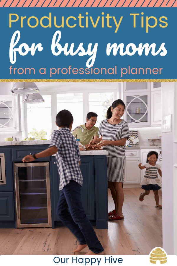 family in the kitchen with children running around the mom and text productivity tips for busy moms from a professional planner