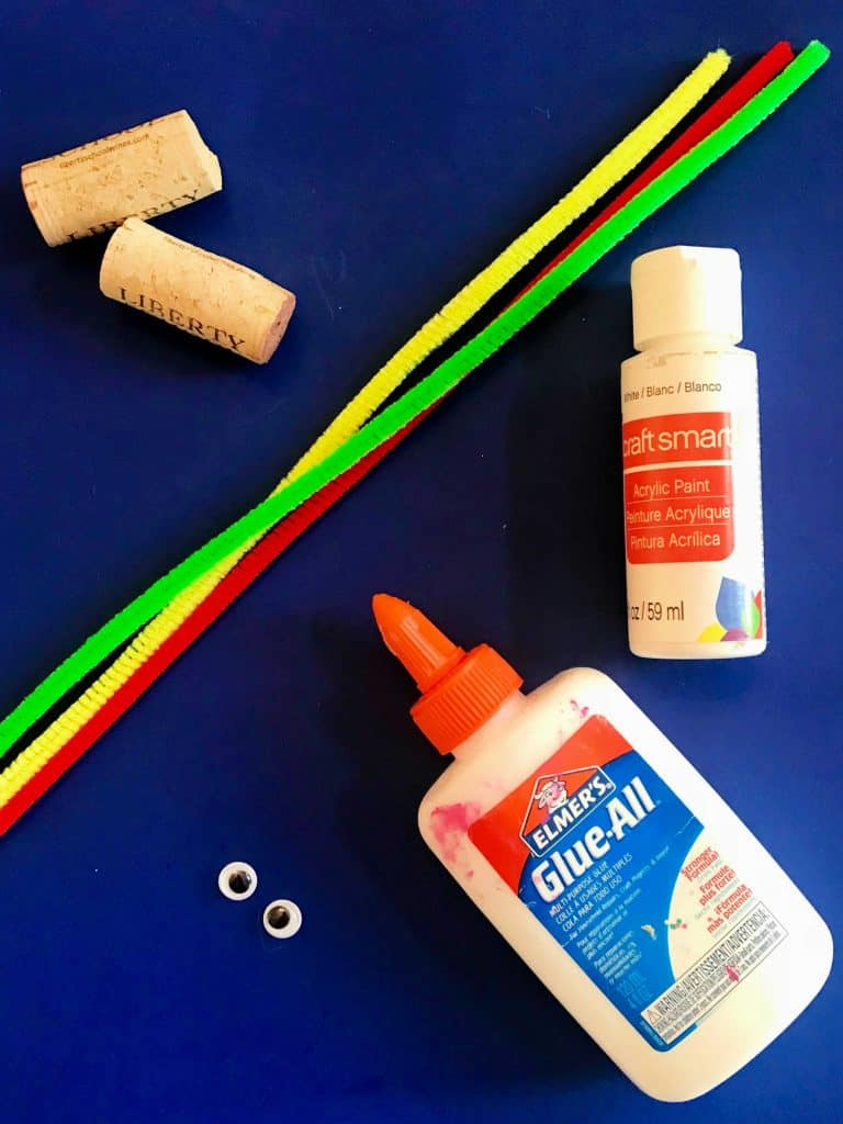 corks, pipecleaners, paint, and google eyes - supplies for snowmen