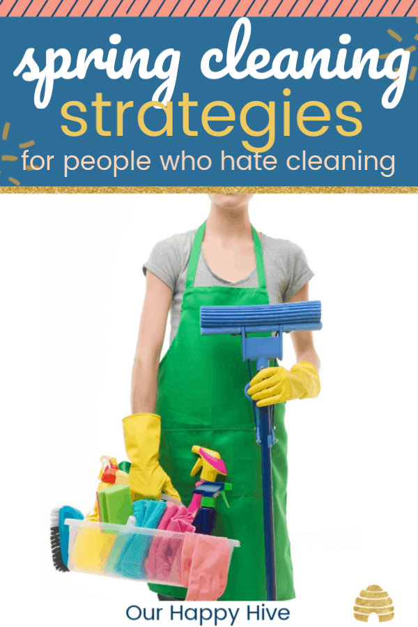 Woman holding cleaning supplies with text Spring Cleaning Strategies for moms who hate cleaning