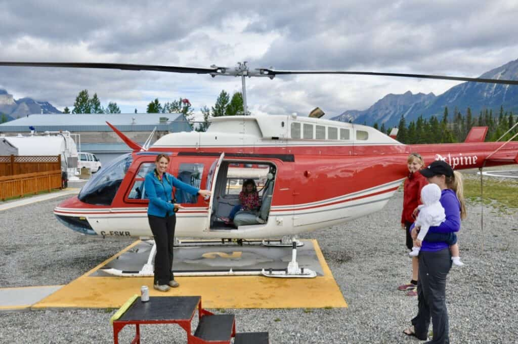 Woman opening the door to a helicopter as an experienced-based clutter free gift.