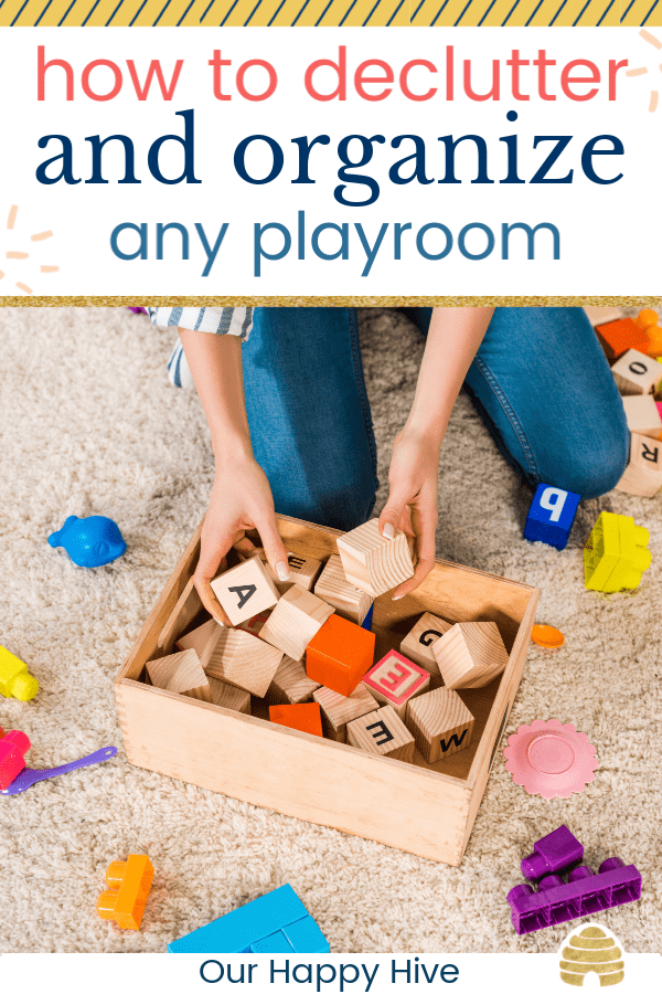 woman putting toy wooden blocks in a box with text how to declutter and organize any playroom