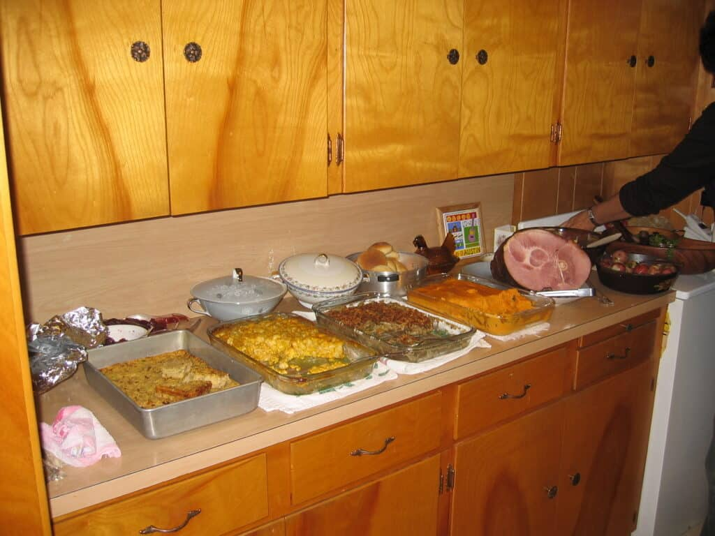 Buffet filled with cassaroles and meat dishes for thanksgiving dinner.