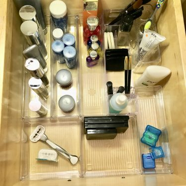 make up organized in dollar store acrylic container