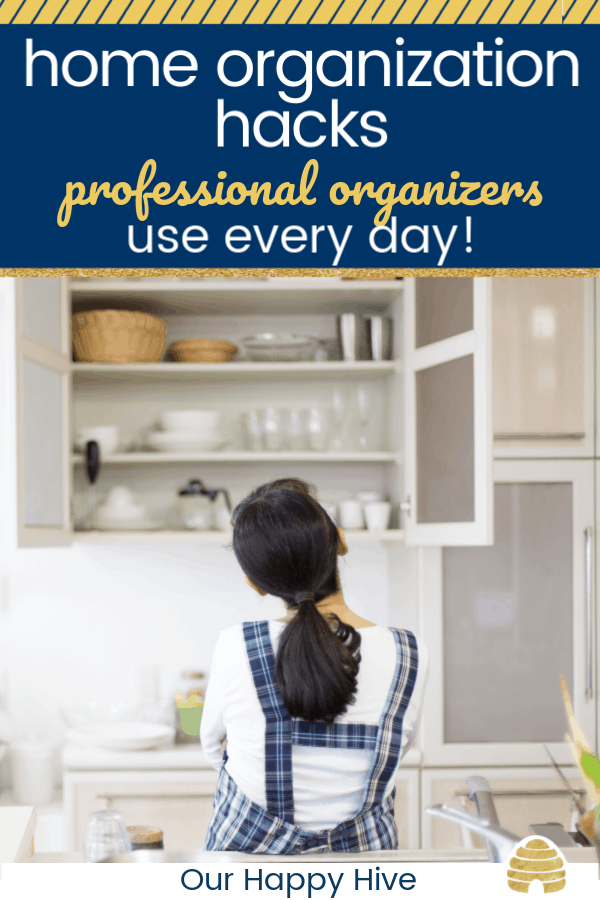 Woman looking at her kitchen wondering how to shart home organization. With text home organization hacks professional organizers use every day