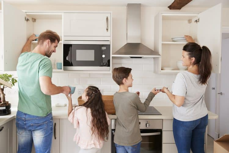 A family working together to organize their kitchen