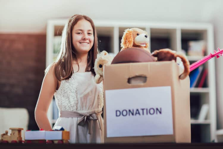 Kid finished decluttering and has a box of things to donate.