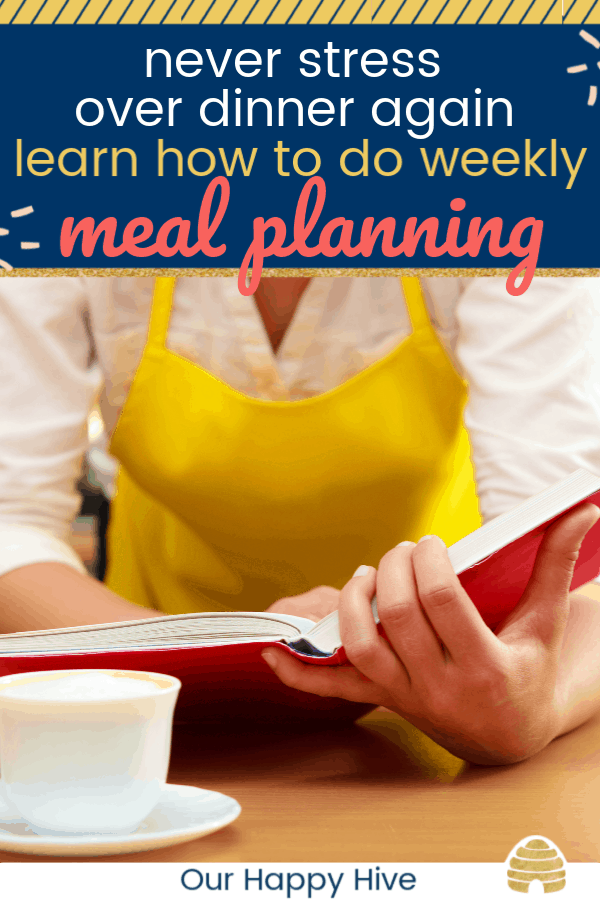 Woman looking at a cookbook doing her weekly meal planning. with text never stress over dinner again learn how to do weekly meal planning