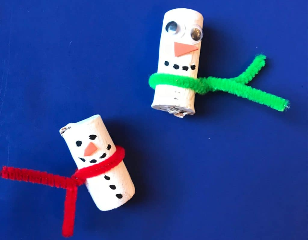 Painted corks with pipecleaners to look like snowmen with scarfs