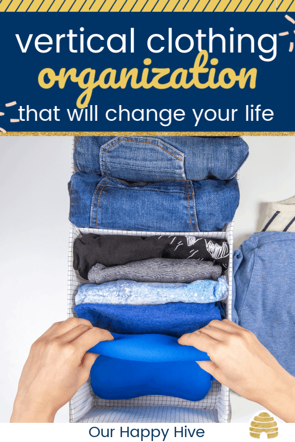 clothing folded in the konmari method with text vertical clothing organization that will change your life